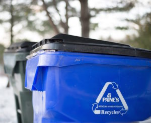 Blue recycling bin.