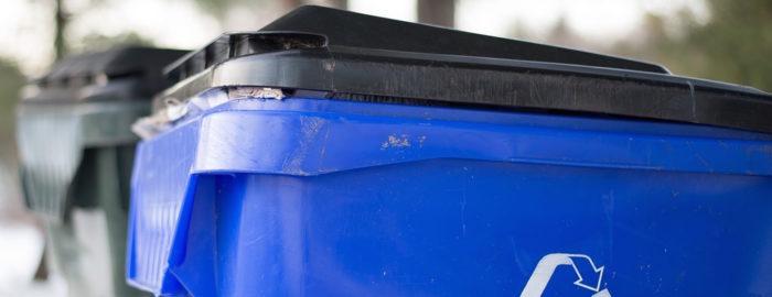 Blue recycling bin.