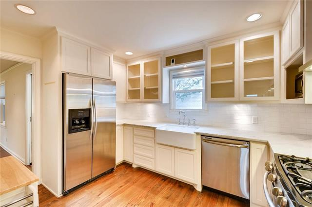 Luxurious kitchen with stainless steel appliances.