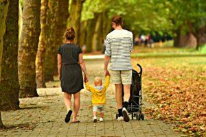 A family taking a walk.