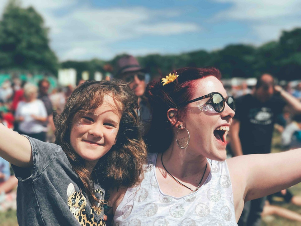 A woman and a girl at a festival.
