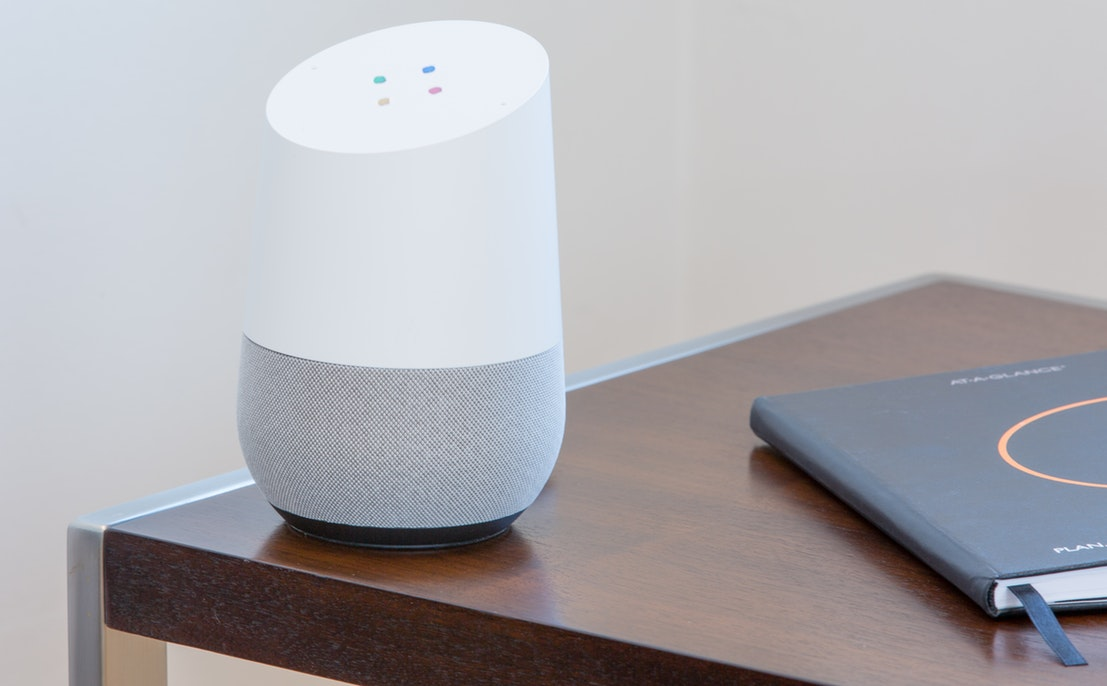 A smart home speaker on a table.