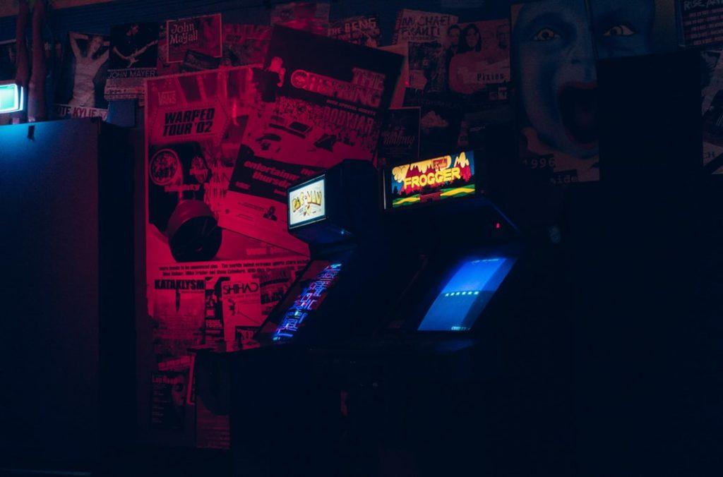 Glowing arcade games, an indoor attraction.