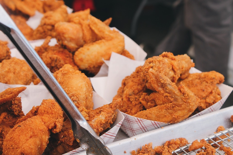 Trays of fried chicken.
