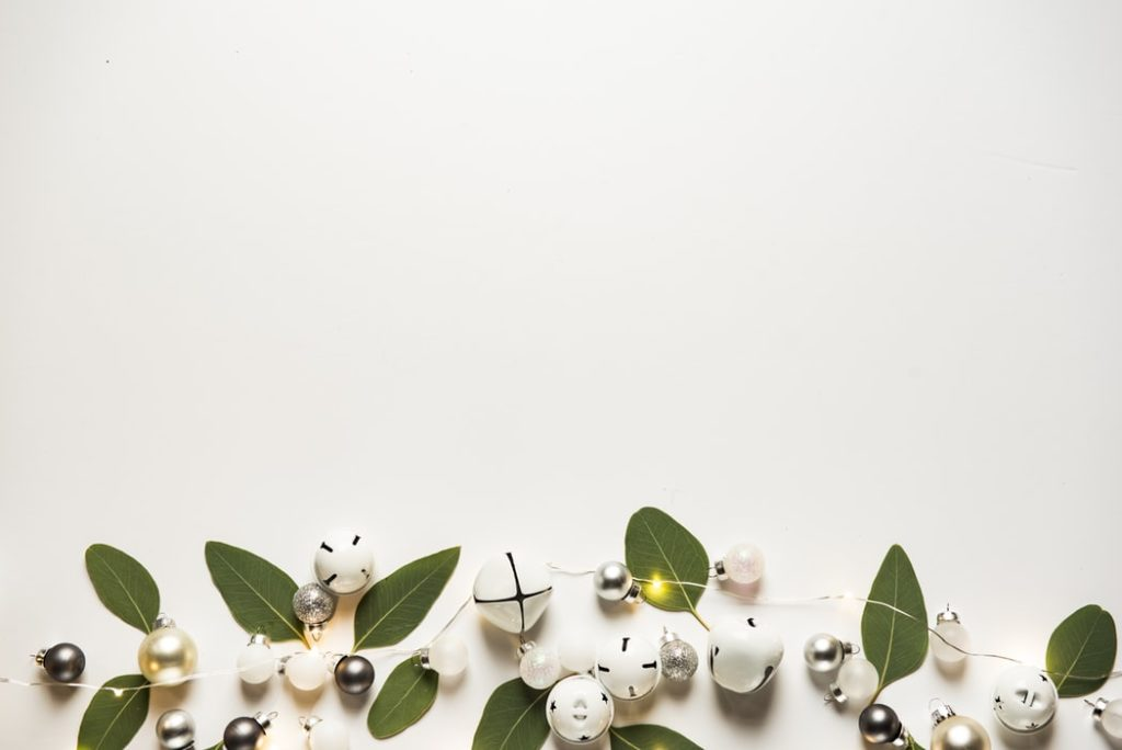White bells, greenery, and lights that reflect a neutral home staging.