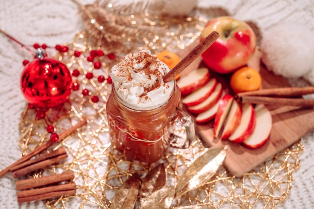Warm cider and holiday snacks during a home staging.