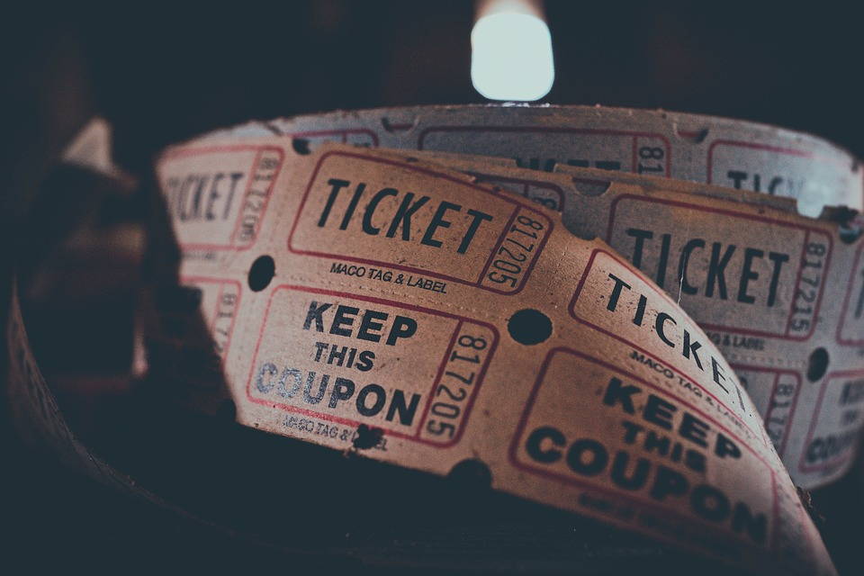 Movie tickets to the theater, an indoor attraction.