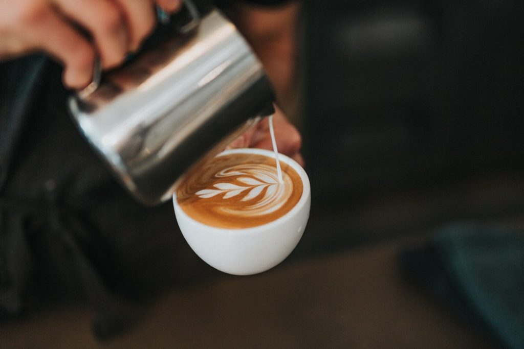 A person making coffee at one of the new Fort Worth restaurants.