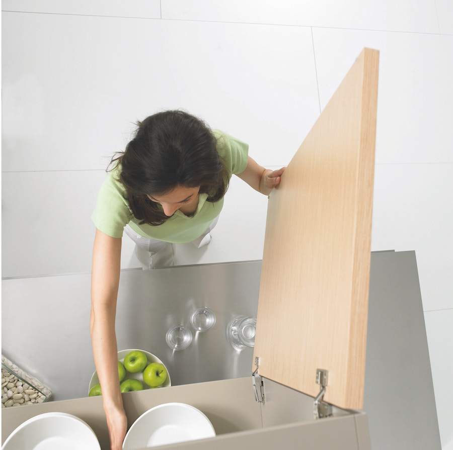 Woman maximizing space in a cabinet