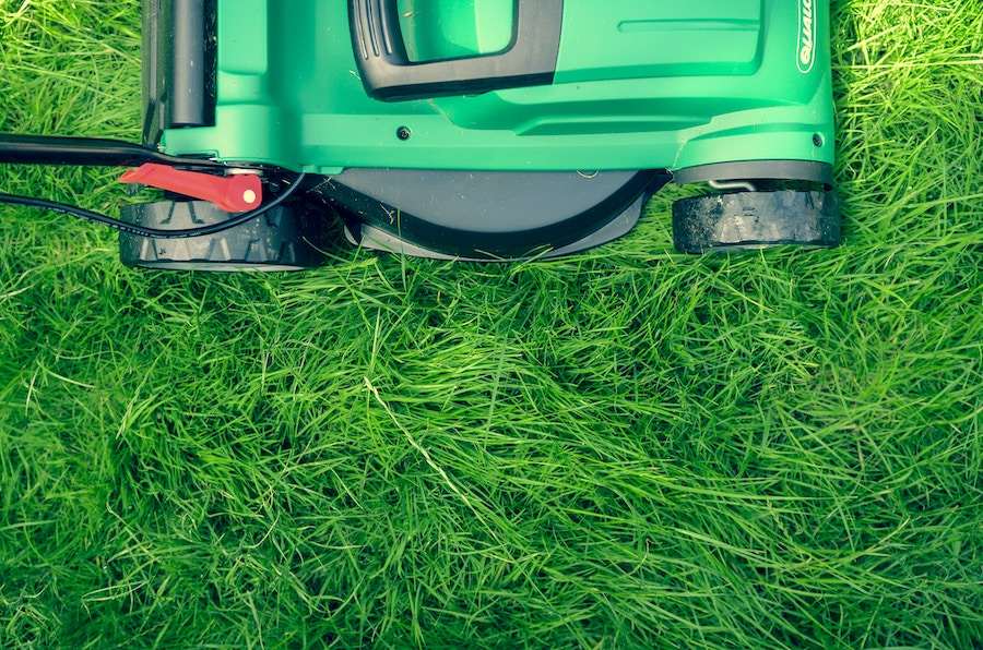 Mowing the long to prep your outdoor space